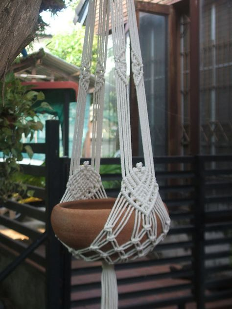 """Two arms Macramé Plant Hanger White Tiara in unbleached poly cotton twisted cord (off- white color), perfect for 8- 9"""" (20-23 cm) diameter x 4(10 cm) height plant pot. Plant pot not included. Size: 39 ½"""" (100 cm) ) overall length (top of the hanger to end of its tassel) Shipping: I ship worldwide, the item will be shipped within 5-7 days of receiving payment. The standard method is registered air mail (by Thailand Post), typically delivered within 10-14 business days from ship date…"""