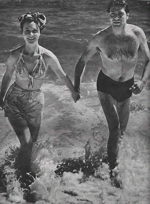 Laurence Olivier and Vivien Leigh hit the beach in Australia's Gold Coast for a little R&R during the Old Vic tour of Australia and New...