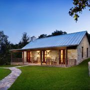 Stone cabin designs exterior farmhouse with standing seam roof stone house rocking chair