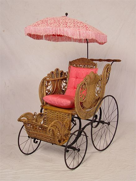 A FANCY VICTORIAN WICKER BABY BUGGY WITH PARASOL