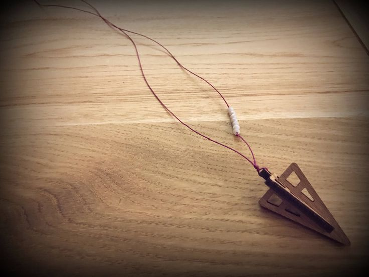 Cord necklace with wooden pendant triangle 3D..