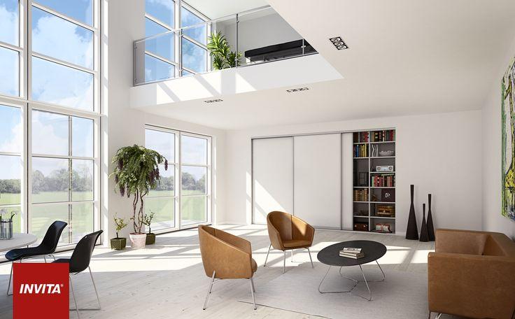 Du kan nemt forene et elegant rum med med masser af familieaktiviteter ved brug af integrerede skabe med store hvide skydedøre, der kan skjule legesager og andet rod.