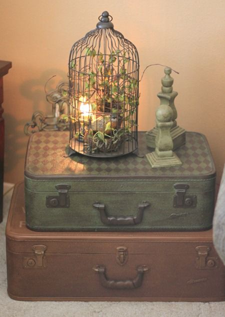 .Top my four stacked suitcases w/ w/ a slim birdcage filled w/ lights or back-lit in foyer.
