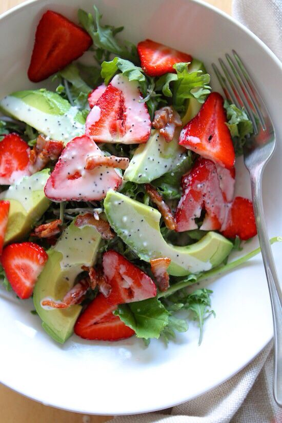 Avocado, strawberry and bacon salad with poppy seed dressing.