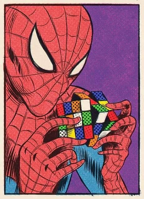 Spiderman trying to build rubik cube