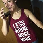 Less whine, more wine...Now there' something we can get on board with! Say it loud and proud with this relaxed fitting racer back slogan tank. Let your tank do the talking!