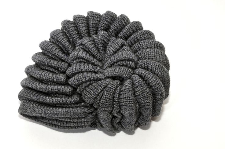 Inspired by the golden spiral found all around us in nature, the Shell Knitted Cushion can also be worn as a mitten.
