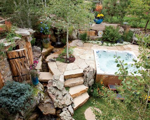 Paver patio with stone steps and hot tub
