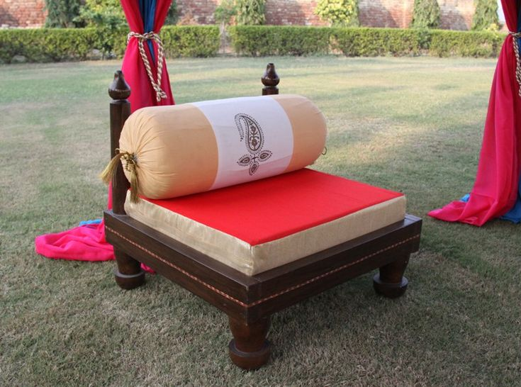 Traditionall handmade low wooden seat, furnished with a foam seat and bolster from Sangeeta International, India