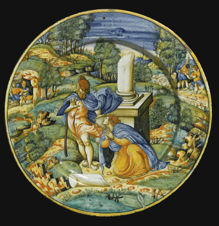 AN URBINO MAIOLICA DISH, WORKSHOP OF ORAZIO FONTANA, CIRCA 1540 painted with the 'noli me tangere' scene of Christ appearing to Mary Magdalene beside a ruined column, in an extensive landscape with figures 42.5cm., 16 3/4 in. Sotheby's