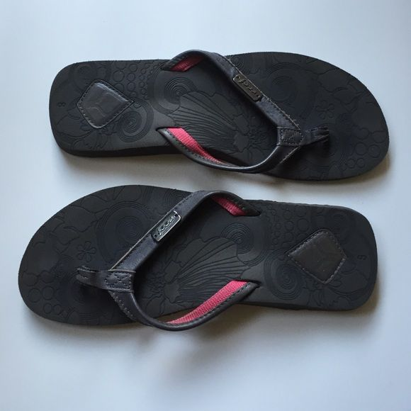 Reef slippers grey and pink Barely used. Leather straps. Amazing arch support. Super soft and cushion-y footbed. Seems slip resistant. Reef Shoes Slippers