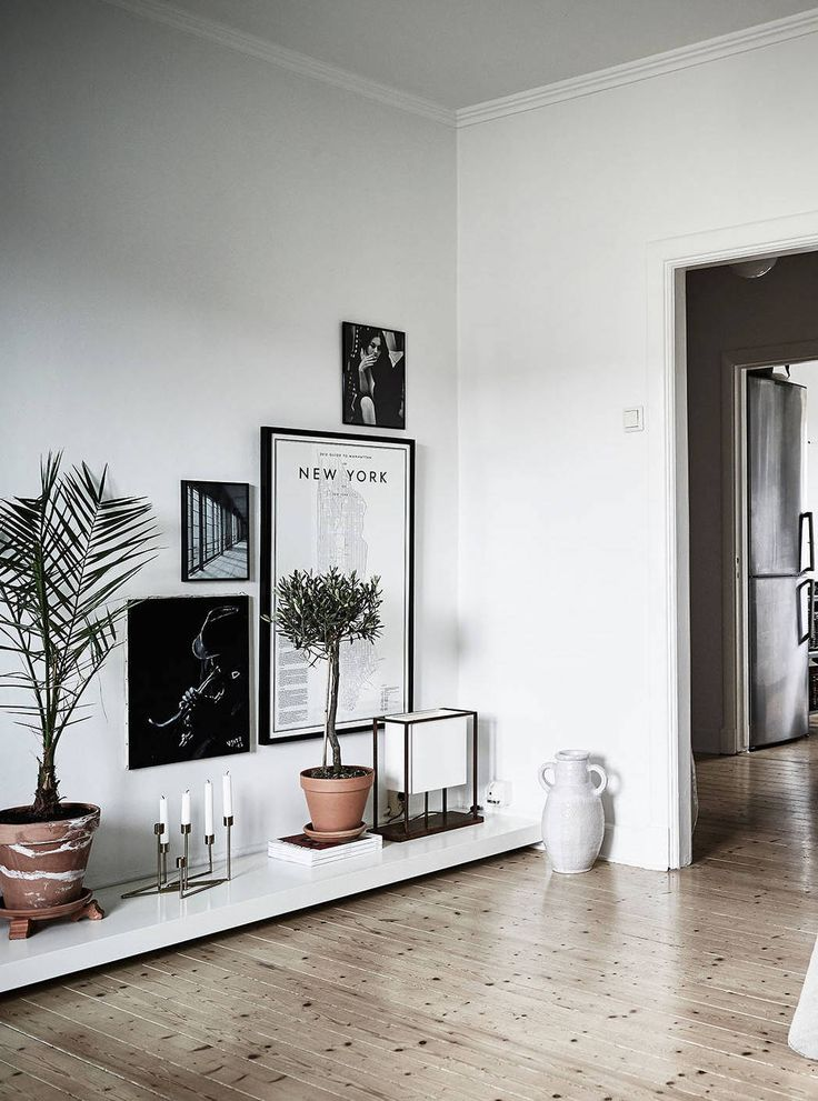 Moody minimalist living space with a gallery wall