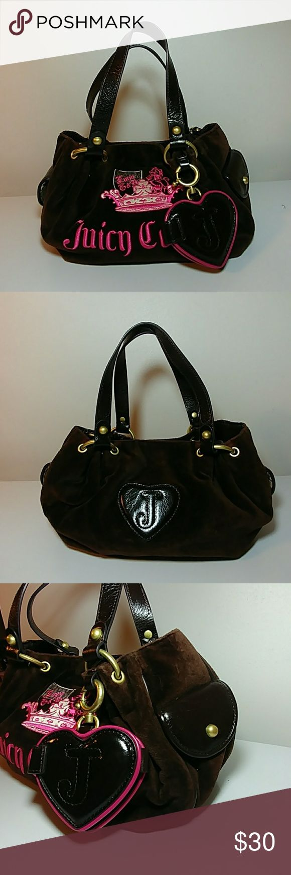 👜💖👜Beautiful JUICY COUTURE Handbag😍💖😜 Up for grabs is this fantastic Juicy Couture Brown velvet handbag. This handbag is in excellent preowned condition. It has a charm in the shape of a heart which is a mirror hanging from the side. Check out my closet for more women's handbags. Thanks for looking. Juicy Couture Bags Shoulder Bags