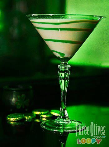 The Loopy Leprechaun1 part Three Olives Loopy Vodka  2 parts Irish Cream Liqueur  Green Colored Simple Syrup (optional for swirling around the inside of the glass)