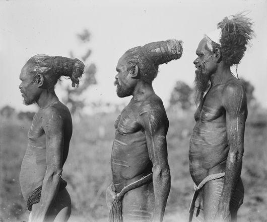 Men displaying different methods of dressing their hair (Cambridge Gulf, Western Australia).