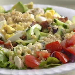 This Cobb salad is true to the original with all the good stuff—chicken, eggs, bacon, avocado and a tangy dressing.