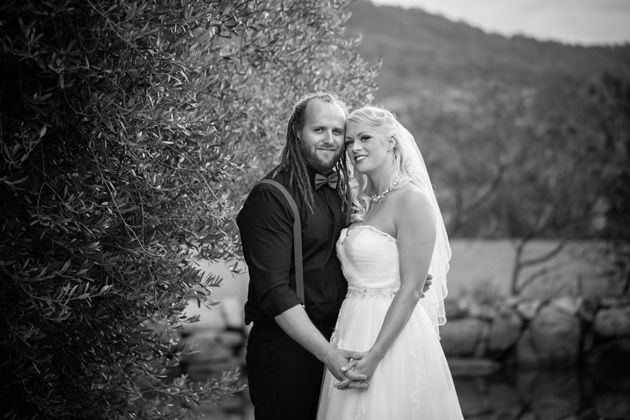 black and white image of the bride and groom smiling at the camera