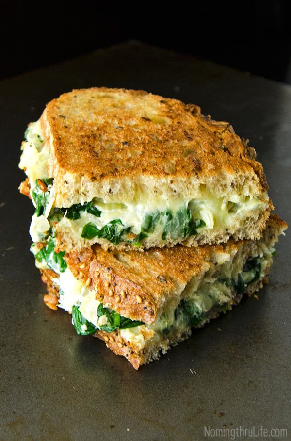 Spinach Artichoke Grilled Cheese Sandwich - Basically spinach artichoke dip smothered between two toasty crunchy pieces of bread. Yum! Recipe @ NomingthruLife.com