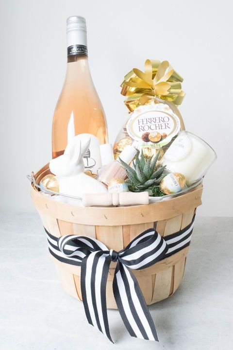 "ADULT EASTER BASKET – Okay, okay, so we know what we said about Easter baskets — but an ""adult"" basket that includes a favorite candle, gourmet chocolate and a fruity rosé? We're on board with that. Click through to view the whole gallery and for more easter gifts."