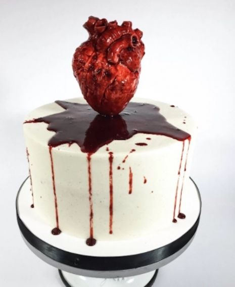 'Till Death Do Us Part': Ghoulish bride & groom serve their 'severed heads' as cake at their wedding | Dangerous Minds
