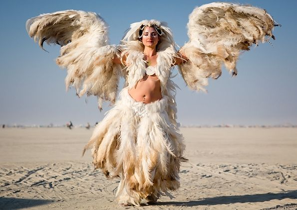 Nom de Plume  A dancer from San Francisco who calls herself Ka appeared at Burning Man 2012 in a breathtaking full-body outfit made almost entirely of feathers.    burning man 2012