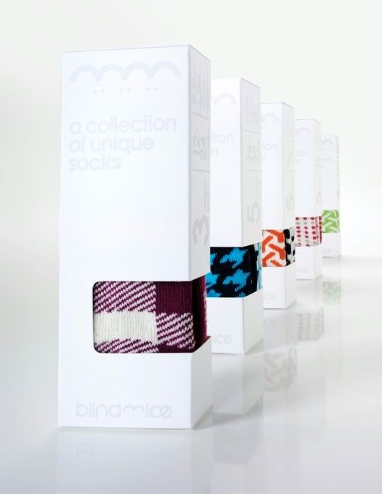 A collection of unique socks. White packaging highlights colorful patterns.