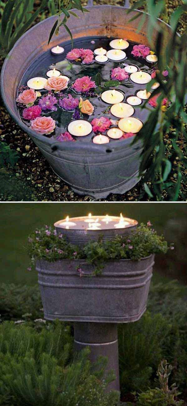 Tea lights and faux flowers in a rustic bucket is the perfect ambient addition to outdoor parties! - summer parties - outdoor DIY