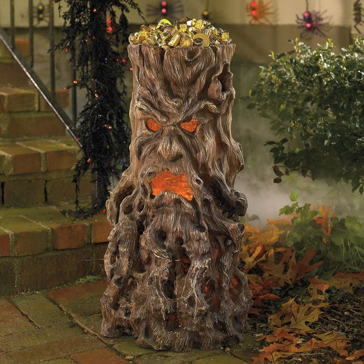 Haunted Tree Stump Candy Stand - several of these in the yard would be cool!