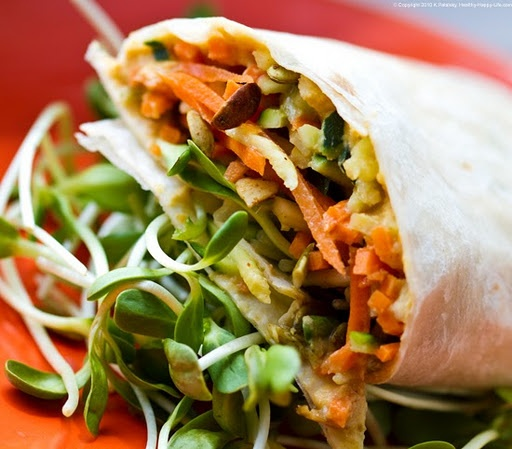 raw spicy wrap filled with savory spicy hummus, crunchy maple/cider ...