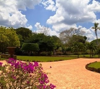 Beautifully kept gardens at Hacienda Kaan Ac - a 16th century restored Haicenda in Valladolid, Mexico.