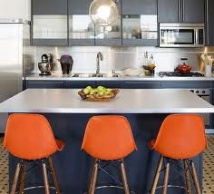 Love the grey and navy with the pop of orange chairs!