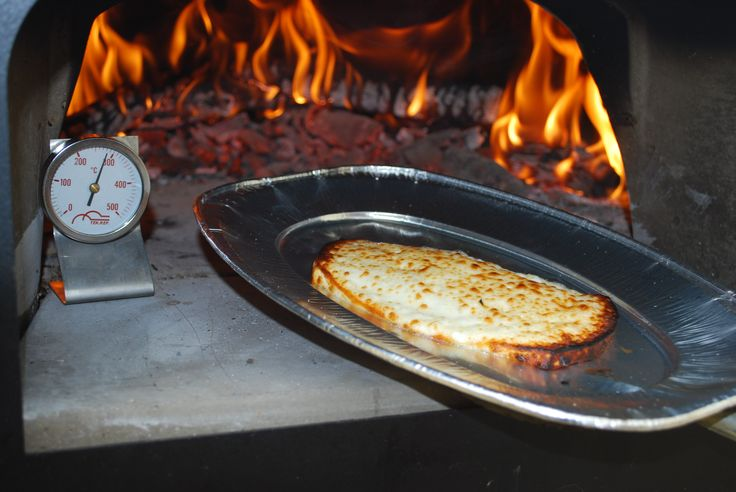 Baked cheese in the #woodburnging #oven #ziociro #subitocotto at 200° for 10 minutes of cooking