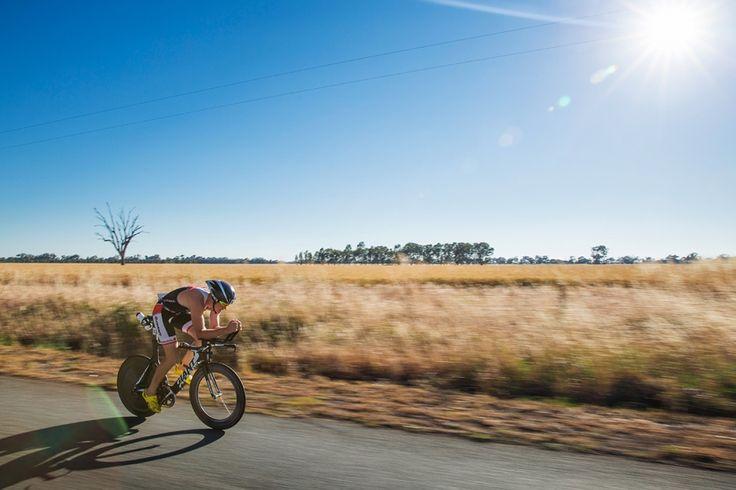 Joseph Lampe (AUS) Riding His Giant TT Bicycle. 2012 Ironman Shepparton 70.3 Triathlon. Shepparton, Victoria, Australia. 18/11/2012. Photo By Lucas Wroe