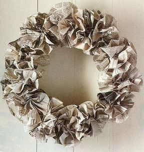 accordion folded paper, wrapped around a clothes hanger, and wired into flowers.  Simple and all recycled.  Love it!!!