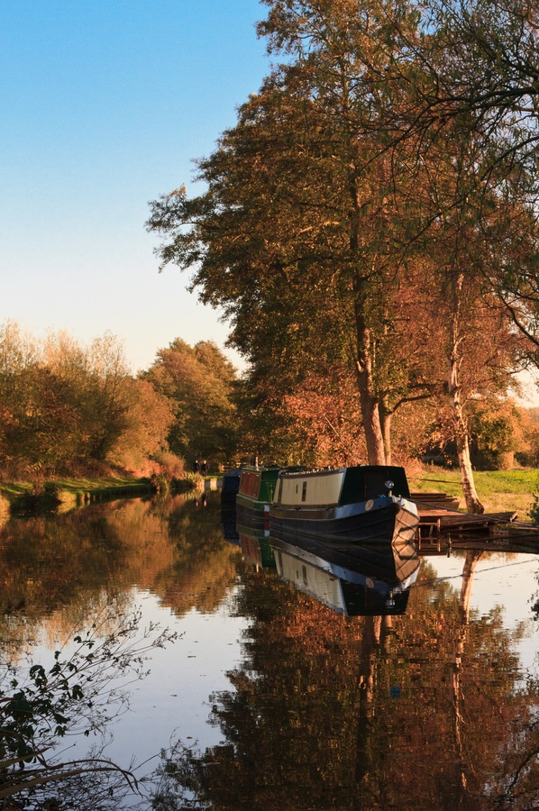 Late afternoon on the Trent and Mersey canal near Fradley Junction in Staffordshire, England. Pass through Fradley Junction when completing the Black Country Ring from Gailey. Visit www.abcboathire.com for more information.