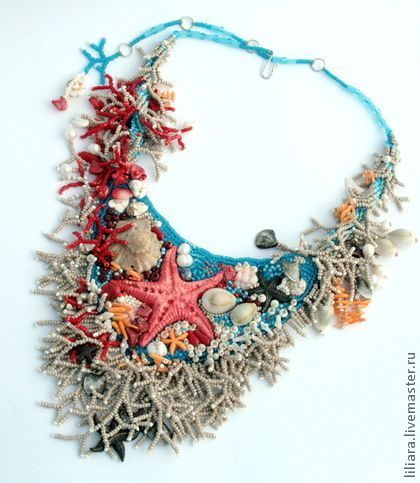Lovely freeform beaded necklace featuring shells, a big starfish and lots of embellishment.