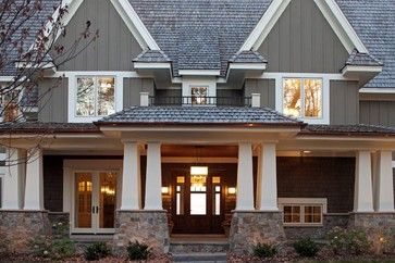 Cedar shingle lower half, James Hardie board and batan siding, painted Benjamin Moore Amherst Gray Deck & Siding Stain, Trim is B. M. Brilliant White.  Stone is Indian Creek.  Architect is Peter Eskuche from Minneapolis, company Stonewood, LLC