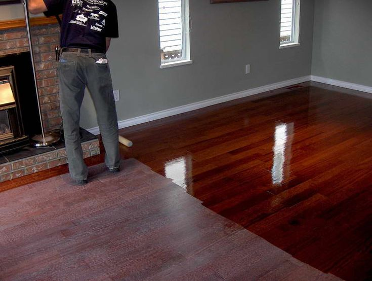 Dark grey walls with cherry floorboards                                                                                                                                                                                 More