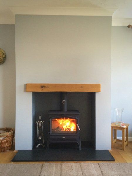 Esse 100 stove, honed granite hearth, oak fireplace beam.jpg