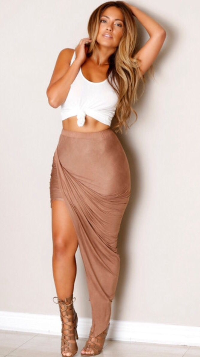 """Who doesn't just love taupe? We do! And we so love this """"Babes in Taupe Land"""" skirt which is fit to a Tee! Skirt features an asymmetrical hem line with short hem and long hem detail while the sides ar"""