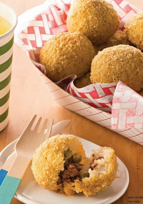 Beef-Stuffed Rice Balls — Lean ground beef and onions are skillet-cooked with tomato sauce and peas and stuffed into rice balls in this family-pleasing baked dish.