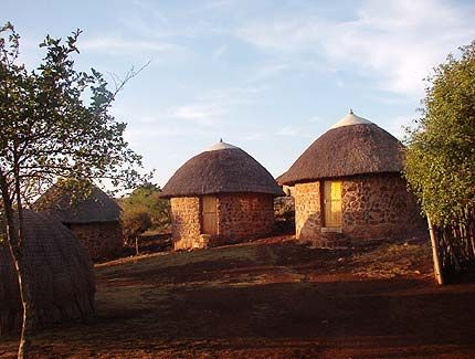 Shewula Mountain Camp - The first eco-cultural programme in Swaziland. Experience a traditional Swazi lifestyle. Food grown in the community is served in the boma by lantern light.