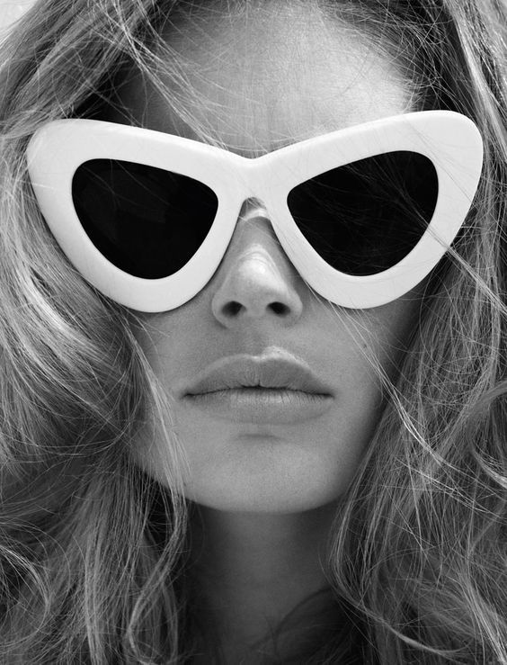 Model rocking these funky retro sunglasses in a close up shot