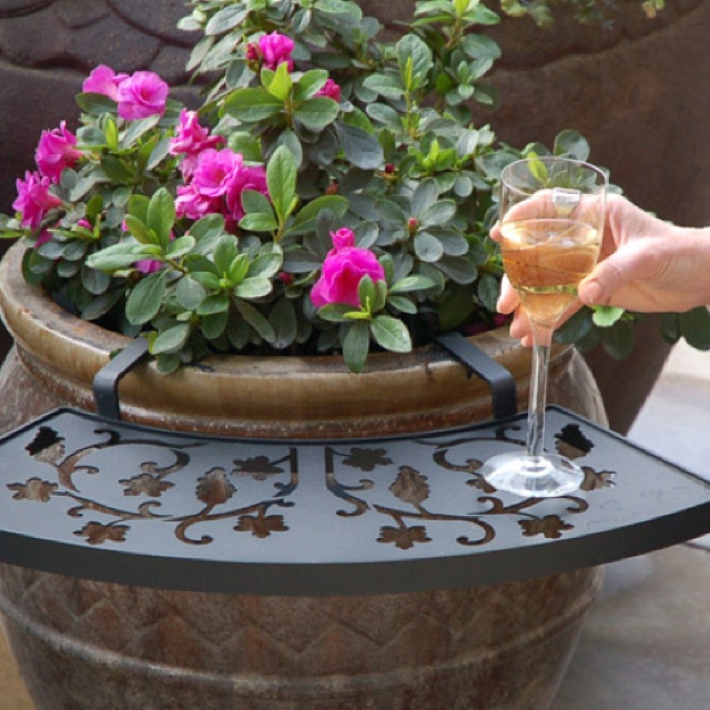"""It's called """"the ledge""""....you attach it to a large flower pot. It can be used to hold a cup of coffee or glass of wine"""