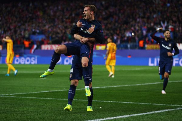 Antoine Griezmann of Atletico celebrates his team's first goal with team mate Gabi during the UEFA Champions league Quarter Final Second Leg match between Club Atletico de Madrid and FC Barcelona at Vincente Calderon on April 13, 2016 in Madrid