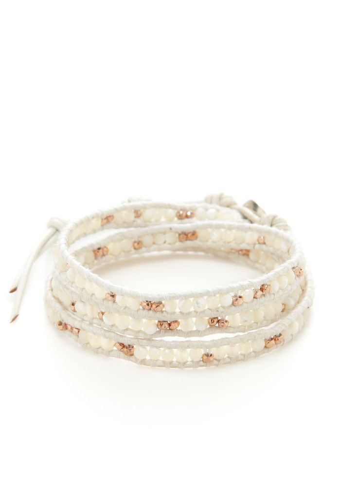 $195   119  Leather cord wrap bracelet with semi-precious stone bead, white mother of pearl, and 14K rose gold vermeil nugget details      20 inches long with 2½ inch extension cord     0.4 inches wide     Loop and sterling silver button closure