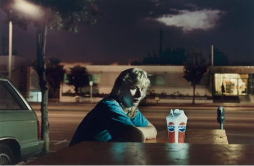 Philip-Lorca diCorcia: Image Title 'Brent Booth' I chose to include this image in my inspiration as I like how it is still considered to be a street scene even though it feels unnaturally quiet. The quiet aspect of this photo and I feel is coming from it being night, and the light is possibly coming from the lights of the shop she appears to be sitting at by herself. I think this is an interesting image because again I am looking for things in the image that will add to a story.