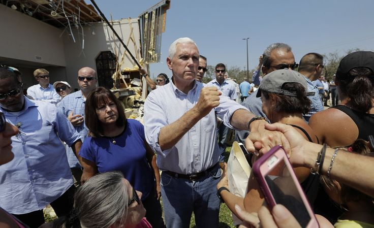 Vice President Mike Pence (center, with his wife, Karen) greets residents affected by Hurricane Harvey during a visit to Rockport, Texas, on Thursday.