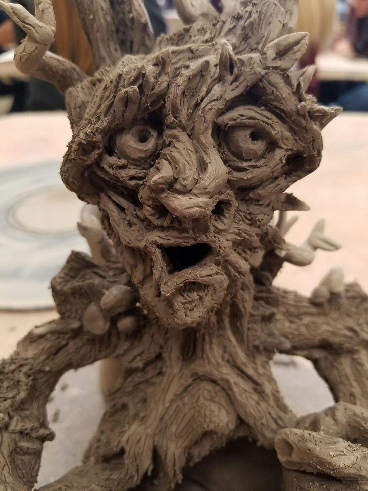 Clay green man. CLOSE UP -Sarah King Hartzler