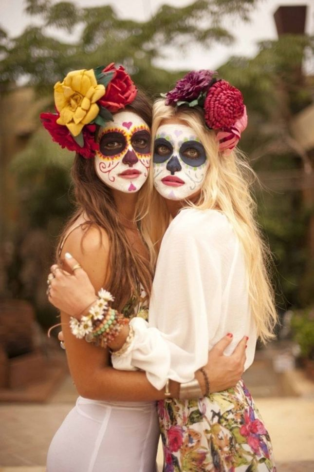 Grab some colorful face makeup and transform into Sugar Skulls for Halloween.